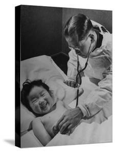 Doctor Examining Giggling Patient Recovering from Cold by Hansel Mieth