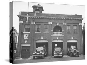 Fire Trucks Sitting Ready to Go at a Firehouse by Hansel Mieth