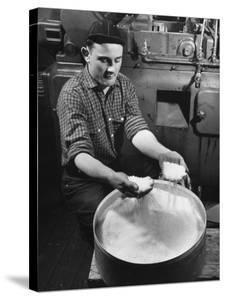 Man Working with Molded Plastics at Barton Molding Co by Hansel Mieth