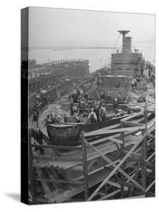 Men Working on the Liberty Ship in the Kaiser Shipyard by Hansel Mieth