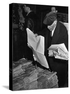 "News Vendor Sorting Through Bundles of the ""Jewish Daily Forward"" by Hansel Mieth"