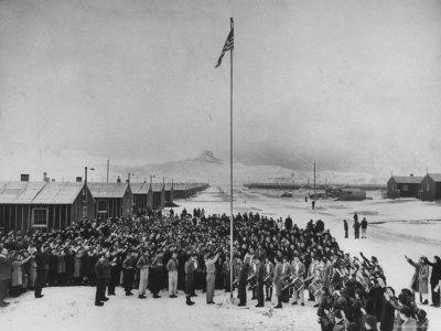 Nisei Japanese Americans Participating in Flag Saluting Ceremony at Relocation Center During WWII
