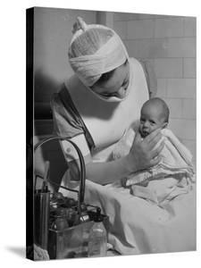 Nurse with Premature Baby by Hansel Mieth