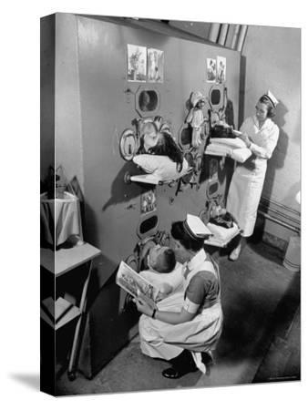 Nurses at Children's Hospital Tending Young Polio Patients Contained in Iron Lung Room