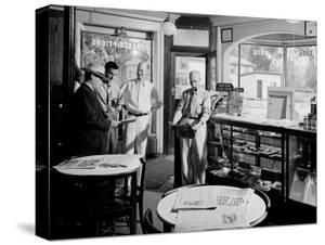 Quartet of Men Gathered in a Local Drug Store in the Hometown of President Franklin D. Roosevelt by Hansel Mieth