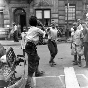 Two Boys Play-Fight While Other Children Look On, Harlem, 1938 by Hansel Mieth