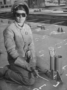 Woman Working as a Ship Welder in the Richmond Shipyards by Hansel Mieth