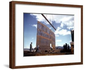 Workers Watching as Steel Beam is Raised High Above During Sub Assembling of Ship at Shipyard by Hansel Mieth