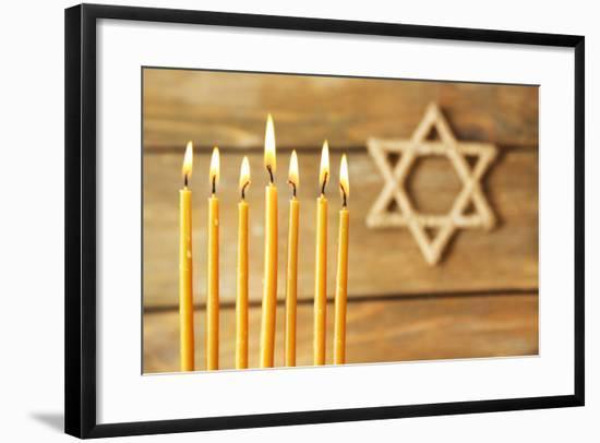 Hanukkah Candle on Wooden Background-Yastremska-Framed Photographic Print