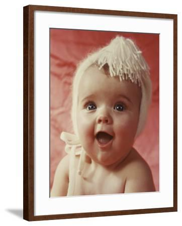 Happy Baby Wearing Wool Hat--Framed Photographic Print