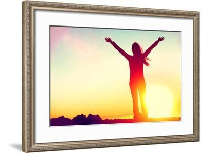 Happy Celebrating Winning Success Woman at Sunset or Sunrise Standing Elated with Arms Raised up Ab-Maridav-Framed Photographic Print