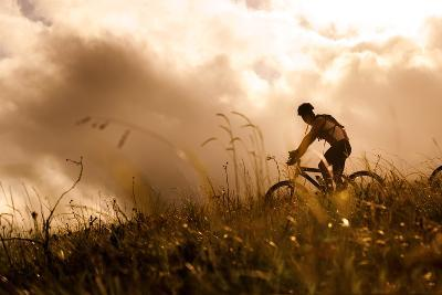 Happy Couple Riding Bicycles Outside, Healthy Lifestyle Fun Concept. Silhouette at Sunset Panoramic-warrengoldswain-Photographic Print