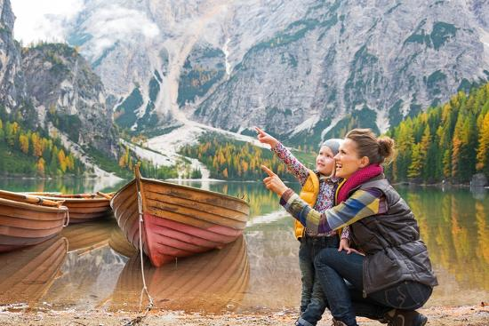 Happy Mother and Baby Pointing on Copy Space While on Lake Braies in South Tyrol, Italy-Mr Alliance-Photographic Print