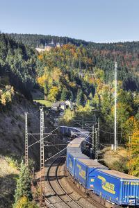 Railroad Line Winds Along a Mountainside, Freight Train, Forest, Scenery, Castle, Houses by Harald Schšn