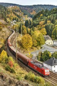 Railroad Line Winds Along a Mountainside, Freight Train, Wood, Scenery, Castle, Houses by Harald Schšn