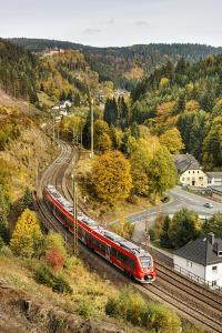 Railroad Line Winds Along a Mountainside, Train, Forest, Scenery, Castle, Houses by Harald Schšn
