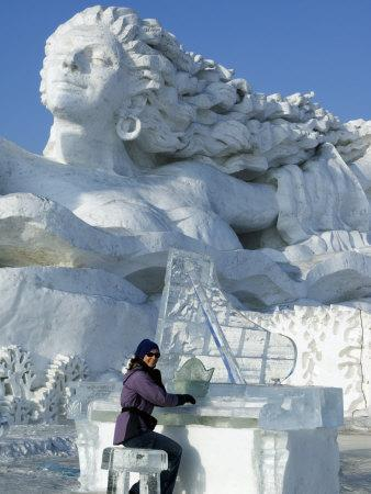 https://imgc.artprintimages.com/img/print/harbin-city-a-tourist-is-playing-a-sculpted-ice-piano-snow-and-ice-festival-china_u-l-p8y0e50.jpg?p=0