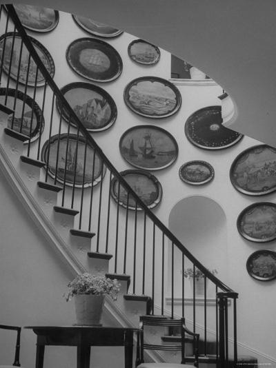 Hard Painted Tray Collection Hanging on the Wall by the Staircase-Nina Leen-Photographic Print