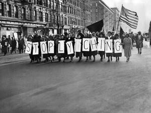Harlem Protests the Scottsboro Verdict as a L-Y-N-C-H-I-N-G