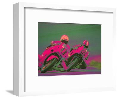 Two People Racing Motorcycles