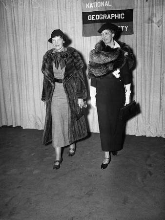 Amelia Earhart arrives with Eleanor Roosevelt to address the National Geographic Society, 1935
