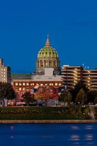 HARRISBURG, PENNSYLVANIA, City skyline and State Capitol shot at dusk from Susquehanna River