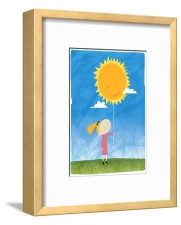 Girl holding a sun balloon