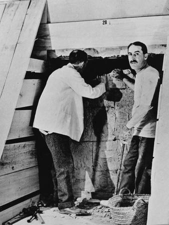 Howard Carter and a colleague excavating a tomb in the Valley of the Kings, Egypt, 1922
