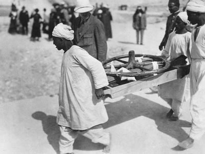 Removing a chariot wheel from the Tomb of Tutankhamun, Valley of the Kings, Egypt, 1922