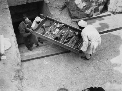 Removing a tray of chariot parts from the Tomb of Tutankhamun, Valley of the Kings, Egypt, 1922