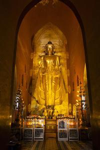 Golden Buddha Statue at Ananda Temple in Bagan, Myanmar by Harry Marx