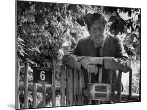 Poet, Wystan H. Auden, Standing Outside Gate of His Home by Harry Redl