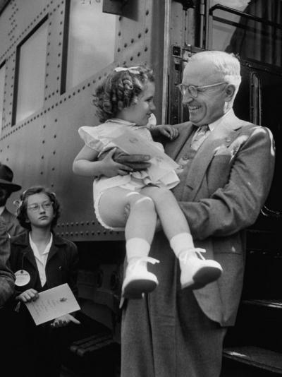 Harry Truman Holding up 3 Yr Old Suzanne Bump after the Town's Postmaster Pressed Her into Service-Hank Walker-Photographic Print