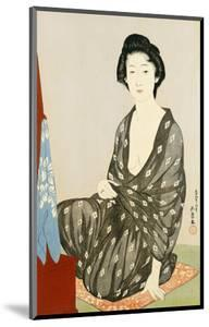 A Beauty in a Black Kimono with White Hanabishi Patterns Seated Before a Mirror by Hashiguchi Goyo