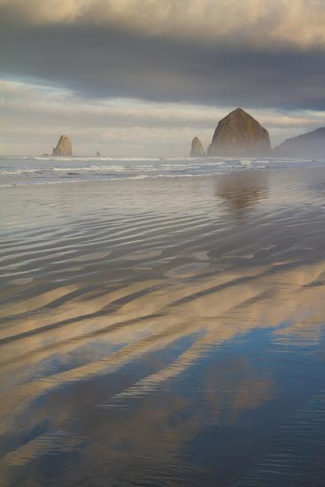 Haystack Rock, the Needles, and Reflections of Clouds at Sunrise-Greg Winston-Photographic Print