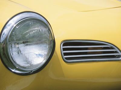 Headlight in Yellow Car--Photographic Print
