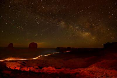 Headlights and Buttes in Monument Valley at Night-Raul Touzon-Photographic Print