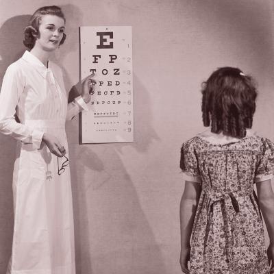 Healthcare Worker Giving Girl (8-10) Eye Examination--Photographic Print