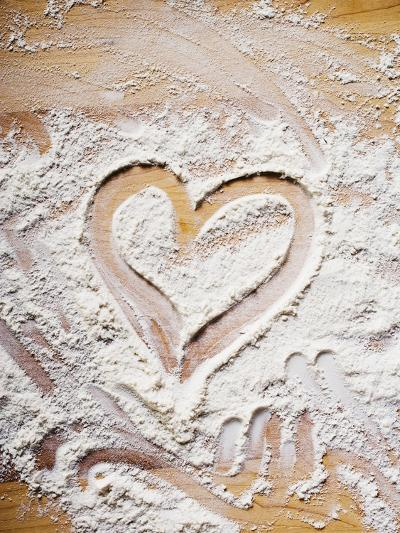 Heart Drawn in Flour on Wooden Background--Photographic Print