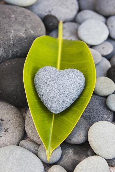 Heart Made of Stone on Green Leaves-Uwe Merkel-Photographic Print