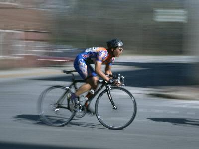 A Bicyclist Speeds Past in a Race