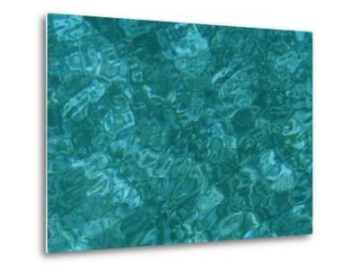 A Detail of Sun-Dappled, Clear Blue Water