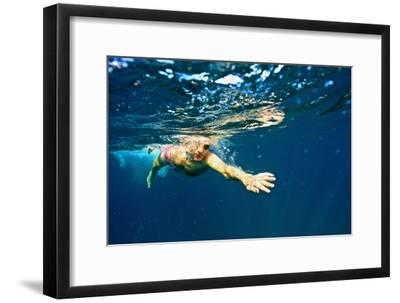 A Man Swims in the Caribbean Sea
