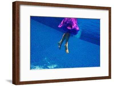 A Model Floats in a Pool, Wearing a Skirt and Heels