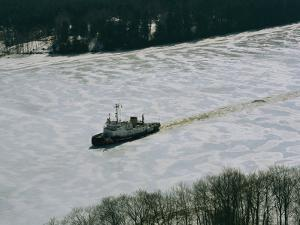 A U.S. Coast Guard Boat Breaks its Way Through the Icy River by Heather Perry