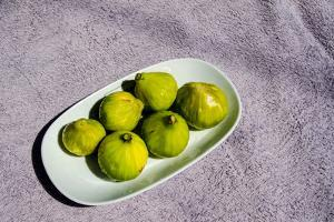 Fresh, Unpeeled Figs on a White Plate by Heather Perry