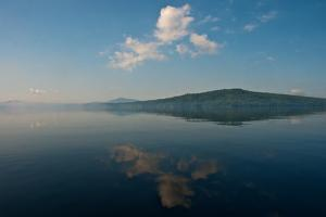 The Sky Is Reflected in the Surface of a Lake by Heather Perry