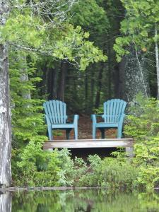 Two Chairs Sit at a Lakeside Camp, Moosehead Lake, Maine by Heather Perry