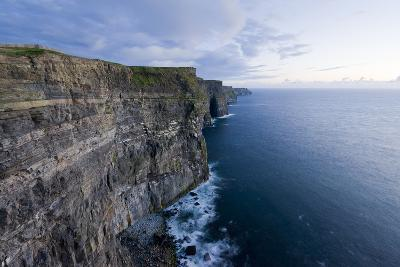 Heavy Clouds Over the Cliffs of Moher and the Atlantic Ocean-Jeff Mauritzen-Photographic Print