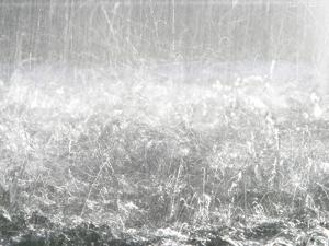 Heavy Raindrops Splashing on the Water